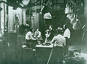 Director on set during the filming of a Silent era film. Circa 1918