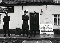 Police protecting pub during RAF Molesworth CND anti-nuclear Easter demo, UK 8 April 1985