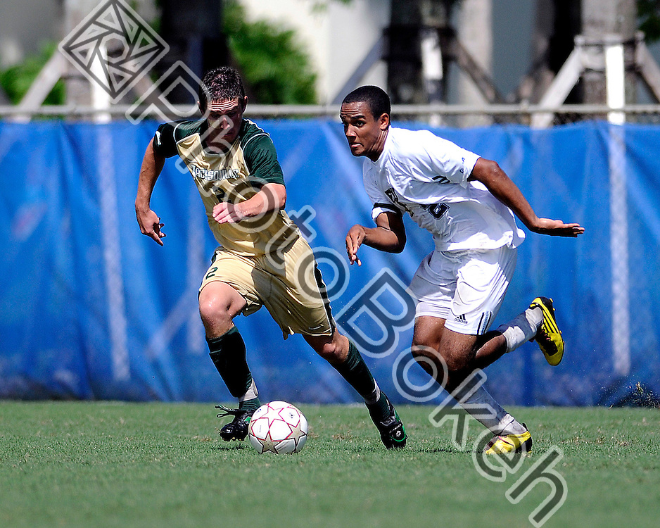 2011 September 11 - FIU Colby Burdette (2) fighting for the ball with Jacksonville Ashton Pett (2). Florida International University Golden Panthers tied Jacksonville University Dolphins, 1-1, at FIU Soccer Complex, Miami, Florida. (Photo by: www.photobokeh.com / Alex J. Hernandez)
