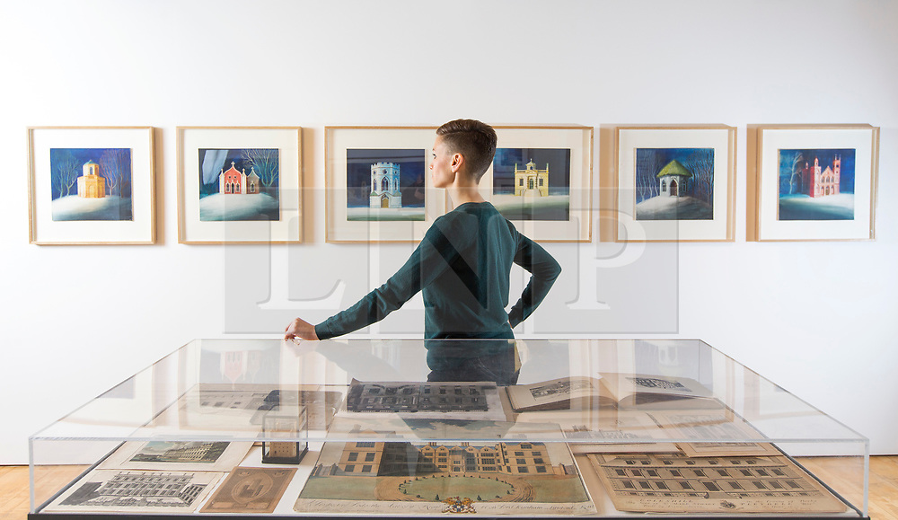 © Licensed to London News Pictures. 09/11/2017. Wakefield UK. Kerry Chase looks at the new exhibition called Sheer Folly-fanciful Buildings of Britain by Artist Ed Kluz at the Yorkshire Sculpture Park. The exhibition celebrates the eccentric, uncanny & overlooked follies, temples & towers that dot the British landscape.  This is the largest solo exhibition to date by the artist, illustrator & printmaker Ed Kluz. Photo credit: Andrew McCaren/LNP