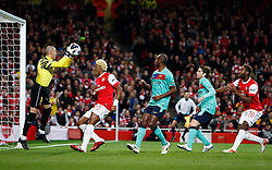 16-02-2011 VOETBAL: ARSENAL - FC BARCELONA: LONDON<br /> Round of last 16, at the Emirates Stadium in London / Barcelonas Victor Valdes  saves ahead of Arsenals Alexandre Song<br /> **NETHERLANDS ONLY** <br /> ©2011-WWW.FOTOHOOGENDOORN.NL/ nph/ Kieran Galvin