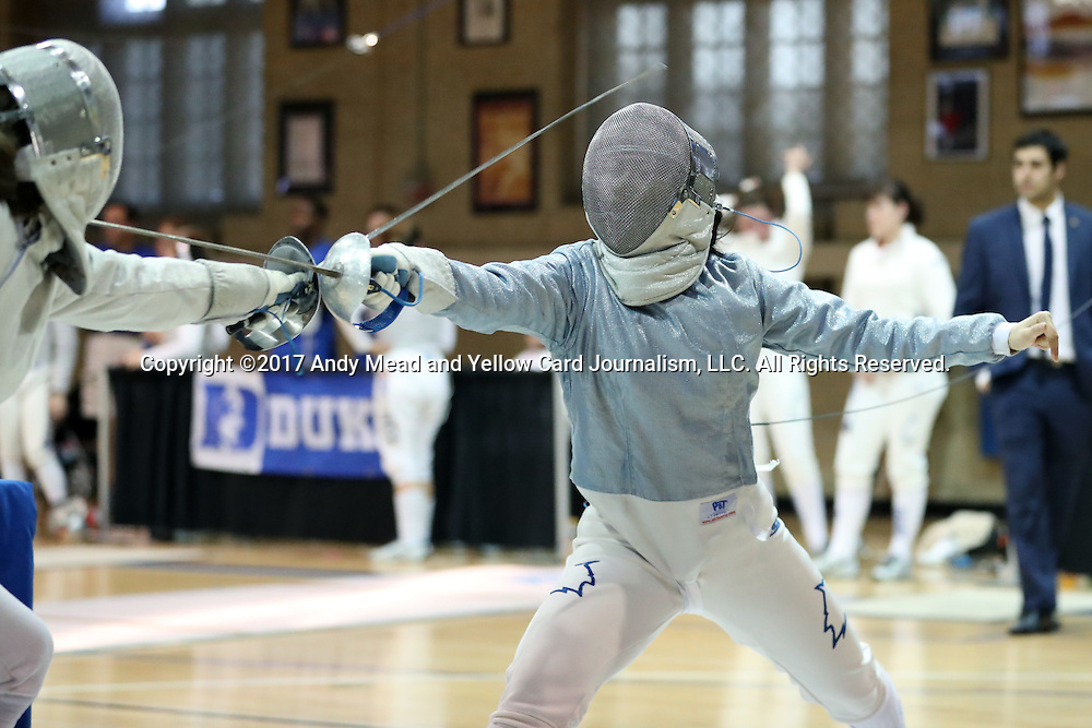 12 February 2017: Duke's Lindsay Sapienza (right) and Boston College's Jackie Bai (left) during Saber. The Duke University Blue Devils hosted the Boston College Eagles at Card Gym in Durham, North Carolina in a 2017 College Women's Fencing match. Duke won the dual match 19-8 overall, 6-3 Foil, 5-4 Epee, and 8-1 Saber.