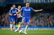 John Terry, the Chelsea captain passing the ball. Barclays Premier league match, Chelsea v Southampton at Stamford Bridge in London on Sunday 15th March 2015.<br /> pic by John Patrick Fletcher, Andrew Orchard sports photography.