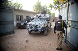 June 24, 2017 - Pakistan - PESHAWAR, PAKISTAN, JUN 24: Security officials cordon off venue during search operation .against criminals at a flour mill in Chamkani area of Peshawar on Saturday, June 24, 2017. The .identities have been ascertained of two terrorists killed during the raid at a flour mill in .Chamkani area of Peshawar earlier morning. According to the security sources, the terrorists .belonged to Daesh-one of them has been identified as Khaleel, an Afghan refugee, while the .other as Fazal Ameen-ul-Maroof. (Credit Image: © PPI via ZUMA Wire)