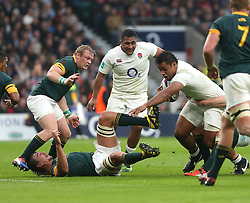 12 November 2016 Twickenham : Rugby Union International Match : England v South Africa :<br /> Eben Etzebeth collides with South African colleague Vincent Koch after a collision with Billy Vunipola (with ball) who is watched by his brother Mako Vunipola.<br /> Photo: Mark Leech