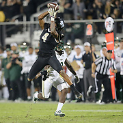 UCF Knights wide receiver Tre'Quan Smith (4) makes a reception during a NCAA football game between the University of South Florida Bulls and the UCF Knights at Spectrum Stadium on Friday, November 24, 2017 in Orlando, Florida. (Alex Menendez via AP)