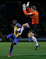 Photo: Steve Bond.<br /> Notts County v Hereford United. Coca Cola League 2. 02/10/2007. Theo Robinson (L) tries to lob onrushing keeper Kevin Pilkington