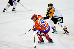 Mitja Robar of Acroni Jesenice vs Jean Philippe Pare of Graz during ice hockey match between HK Acroni Jesenice and  Moser Medical Graz 99ers in 24th Round of EBEL league, on December 3, 2010 in Arena Podmezakla, Jesenice, Slovenia.  (Photo By Vid Ponikvar / Sportida.com)
