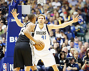 Dallas Mavericks power forward Dirk Nowitzki (41) defends San Antonio Spurs center Boris Diaw (33) at American Airlines Center in Dallas, Texas, on January 25, 2013.  (Stan Olszewski/The Dallas Morning News)