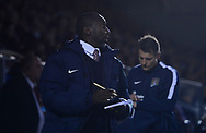 Jimmy Floyd Hasselbaink, the manager of Northampton Town makes notes in his book. EFL Skybet Football League one match, Northampton Town v Portsmouth at the Sixfields Stadium in Northampton on Tuesday 12th September 2017. <br /> pic by Bradley Collyer, Andrew Orchard sports photography.