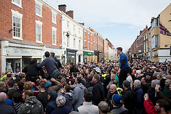 © Licensed to London News Pictures. 28/02/2017. Atherstone, UK.  Competitors wait to start the Atherstone Ball Game on Shrove Tuesday, a tradition that dates from the 12th century, in which the locals fight over a ball up and down the streets town in Warwickshire. Photo credit: ISABEL INFANTES / LNP