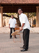 Men playing cricket in a town square, Galle, Sri Lanka