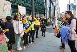 London, UK. 10th April 2019. Laura Pidcock, Shadow Minister for Business Energy & Industrial Strategy, addresses outsourced workers belonging to the Public & Commercial Services (PCS) union standing on a picket line outside their place of work at the Government Department for Business, Energy and Industrial Strategy (BEIS) during strike action to demand a real living wage of £10.55 per hour (the Living Wage Foundation's London Living Wage) and terms and conditions comparable with civil servants who work in the same department.