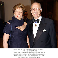 SIR TREVOR & LADY CHINN at a dinner in London on 30th May 2002.PAN 92