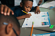 """BIRMINGHAM, AL – MARCH 7, 2017: Third grader Courtney Crosby at Glen Iris Elementary practices the upstroke during a cursive writing class with Afsaneh Beauvais. Beauvais, an elementary school teacher of three years, believes cursive writing is valuable even in the digital world. """"It's relevant to real life,"""" Beauvais said. """"If nothing else, everybody has to sign their name."""" <br /> <br /> With the adoption of Common Core standards in 2010, school districts have begun to weigh the value of cursive writing compared to modern communication methods favoring laptops, tablets and cell phones. The discipline, once considered an academic rite of passage for young students, is now at risk of being replaced as school districts nationwide weigh the value of cursive writing.<br /> CREDIT: Bob Miller for The Wall Street Journal<br /> CURSIVE"""