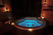 a romantic whirlpool in the interior of a rural guesthouse cabin.