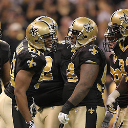16 January 2010:  New Orleans Saints linebacker Jonathan Vilma (51) talks to teammates in the huddle during a 45-14 win by the New Orleans Saints over the Arizona Cardinals in a 2010 NFC Divisional Playoff game at the Louisiana Superdome in New Orleans, Louisiana.