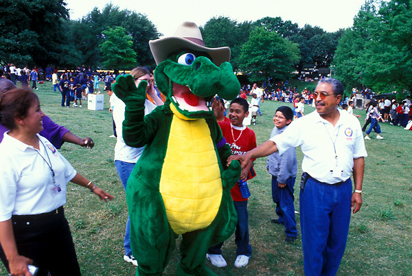 Stock photo of a crowd with an alligator mascot at the International Festival in downtown Houston Texas
