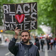 June 3, 2020, London, England, United Kingdom: People participate in a Black Lives Matter protest rally, which started in Hyde Park central London and continued marching towards US Embassy through Trafalgar Square, Downing Street up to the Parliament Square, Lambeth Bridge (in the picture) towards the US Embassy on Wednesday, Jun 3, 2020 - in memory of George Floyd who was killed on May 25 while in police custody in the US city of Minneapolis. (Credit Image: © Vedat Xhymshiti/ZUMA Wire)