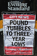 A detail of the London Evening Standard vendor with a headline dated 3rd September about a falling Pound rate, the consequences of a possible No-deal Brexit, in the City of London, aka The Square Mile the capitals financial district, on 3rd September 2019, in London, England.