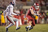 FAYETTEVILLE, AR - NOVEMBER 22:  Brooks Ellis #51 of the Arkansas Razorbacks intercepts a pass in the fourth quarter of a game against the Ole Miss Rebels at Razorback Stadium on November 22, 2014 in Fayetteville, Arkansas.  The Razorbacks defeated the Rebels 30-0.  (Photo by Wesley Hitt/Getty Images) *** Local Caption *** Brooks Ellis