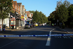 © Licensed to London News Pictures. 22/09/2021. London, UK. The crime scene on Green Lanes, Haringey in north London following a fatal shooting. Police were called just after 10.30 pm on Tuesday 21, September to reports of a man shot on Green Lanes, close to Turnpike Lane underground station. Officers including firearm officers, attended with the London Ambulance Service and the London Air Ambulance. Despite their efforts, a man in his early 20s was pronounced dead at the scene at 10.56pm. Photo credit: Dinendra Haria/LNP