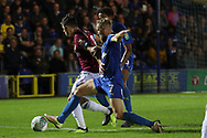 AFC Wimbledon midfielder Scott Wagstaff (7) tackling West Ham United defender Aaron Cresswell (3) during the EFL Carabao Cup 2nd round match between AFC Wimbledon and West Ham United at the Cherry Red Records Stadium, Kingston, England on 28 August 2018.