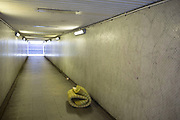 Foam matress of a homeless person rolled up in an underpass in Edgware in London, England, United Kingdom.