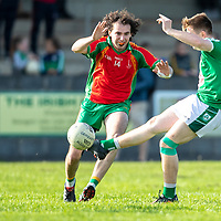 Kilrush Shamrock's Liam Madigan shot is blocked by O'Curry's-Naomh Eoin's Conor Magner
