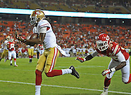 KANSAS CITY, MO - AUGUST 16:  Wide receiver Chuck Jacobs #1 of the San Francisco 49ers catches a 14-yard touchdown pass against defensive back Neiko Thorpe #38 of the Kansas City Chiefs during the second half on August 16, 2013 at Arrowhead Stadium in Kansas City, Missouri.  The 49ers won 15-13. (Photo by Peter Aiken/Getty Images) *** Local Caption *** Chuck Jacobs;Neiko Thorpe