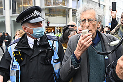 © Licensed to London News Pictures. 17/10/2020. London, UK. PIERS CORBYN is approached by police as Protesters take part in the March For Freedom demonstration organised by Stand Up X. The group are against the Covid-19 restrictions including the wearing of face masks and the erosion of civil liberties. London, UK. Photo credit: Ray Tang/LNP