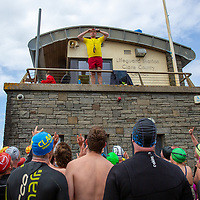 Lifeguard taking a photo of the group before they leave to do the charity swim from Lahinch to Liscannor
