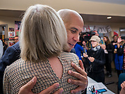 19 DECEMBER 2019 - URBANDALE, IOWA: US Senator CORY BOOKER (D-NJ) hugs a volunteer at his presidential campaign headquarters in Urbandale, a suburb of Des Moines. Sen. Booker, who did not qualify for the December 19 debate in Los Angeles, campaigned in the Des Moines area Thursday and visited the phone bank at his Iowa campaign headquarters. Iowa traditionally holds the first event of the presidential election cycle. The Iowa caucuses at Feb. 3, 2020.              PHOTO BY JACK KURTZ