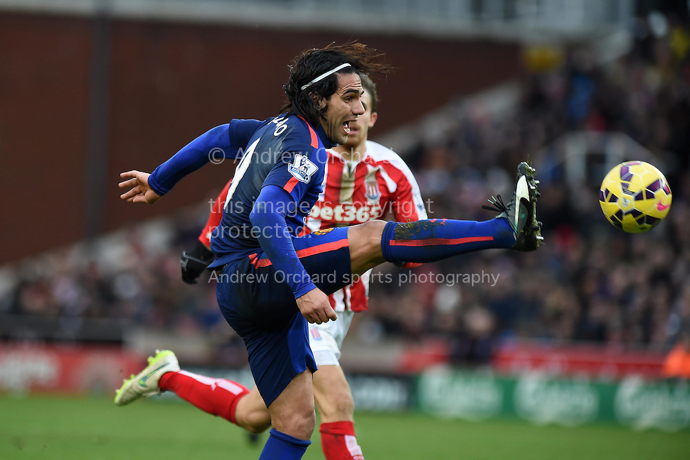 Radamel Falcao of Manchester Utd looks to get onto the end of a long ball.  Barclays Premier league match, Stoke city v Manchester Utd at the Britannia Stadium in Stoke on Trent, Staffs on New Years Day , Thursday 1st Jan 2015. pic by Andrew Orchard. Andrew Orchard sports photography.