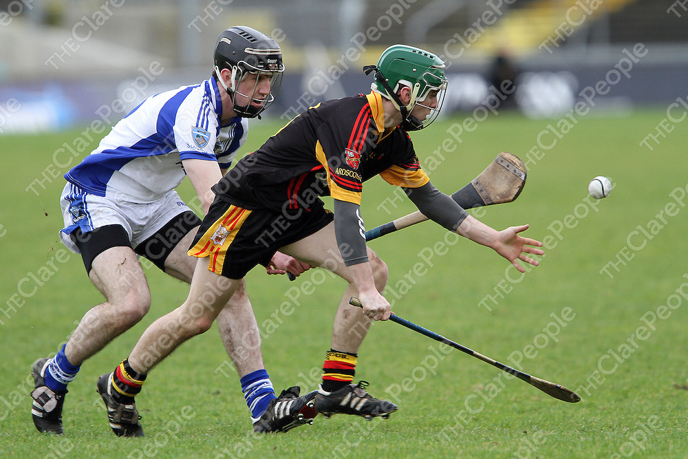 Oisín Hickey Ard Scoil Rís & Meelick gathers possession under pressure from Stephen O'Halloran St Flannan's during the Harty Cup Semi Final in Limerick. - Photograph by Flann Howard