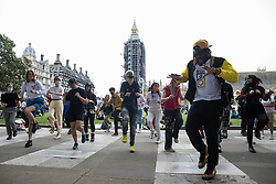 London, UK. 5th July, 2021. Activists dance at a Kill The Bill protest in Parliament Square against the Police, Crime, Sentencing and Courts (PCSC) Bill 2021 as MPs consider amendments to the Bill in the House of Commons. The PCSC Bill would grant the police a range of new discretionary powers to shut down protests.