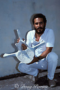 Oswald Vasquez of CIBIMA ( Center for Marine Biology Investigations of Autonomous University of Santo Domingo ) with humpback whale vertebra, Dominican Republic