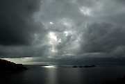 Small patch of sunlight on Adriatic Sea, under stormy skies, near Dubrovnik, Croatia