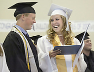 Sullivan West's Ashley Murphy, right, smiles at classmate Bret Reimer after looking at her diploma during graduation at the school in Lake Huntington on June 23, 2007.