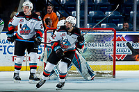 KELOWNA, BC - MARCH 6: Jake Lee #21 and Nolan Flamand #12 of the Kelowna Rockets look for the pass during second period against the Seattle Thunderbirds at Prospera Place on March 6, 2020 in Kelowna, Canada. (Photo by Marissa Baecker/Shoot the Breeze)