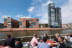 Modern apartment and office buildings  on waterfront of River Elbe viewed from tour boat in Hamburg Germany