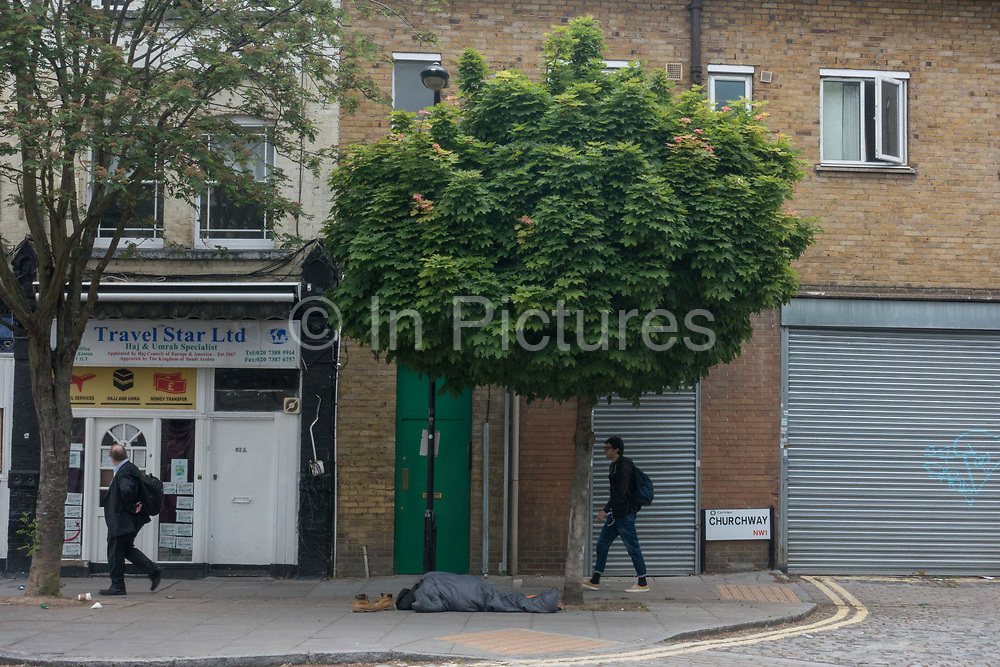 A homeless person in a sleeping bag under a tree on the 16th May 2019 in North London in the United Kingdom.