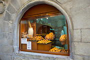 Food shop selling artisan bread and cakes in Calle Mayor in town of Laguardia, Rioja-Alavesa, Basque country, Spain