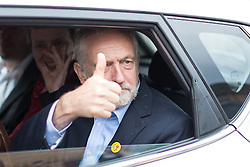 © Licensed to London News Pictures . 24/09/2016 . Liverpool , UK . JEREMY CORBYN gives a thumbs up as he leaves a visit to Beaconsfield Community House in Birkenhead , following his victory declaration . The centre provides clothes and food that would otherwise be destined for waste from supermarkets , to local residents in need . Photo credit : Joel Goodman/LNP