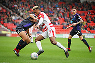 Doncaster Rovers forward Mallik Wilks (7) on the attack during the EFL Sky Bet League 1 match between Doncaster Rovers and Luton Town at the Keepmoat Stadium, Doncaster, England on 8 September 2018.