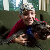 (PPAGE1) Pt. Pleasant 9/9/2004  Carly Roncin was diagnosed with a rare and aggressive type of brain cancer.  We are revisiting how she and her dog Jack are doing.  Michael J. Treola Staff Photographer.....MJT