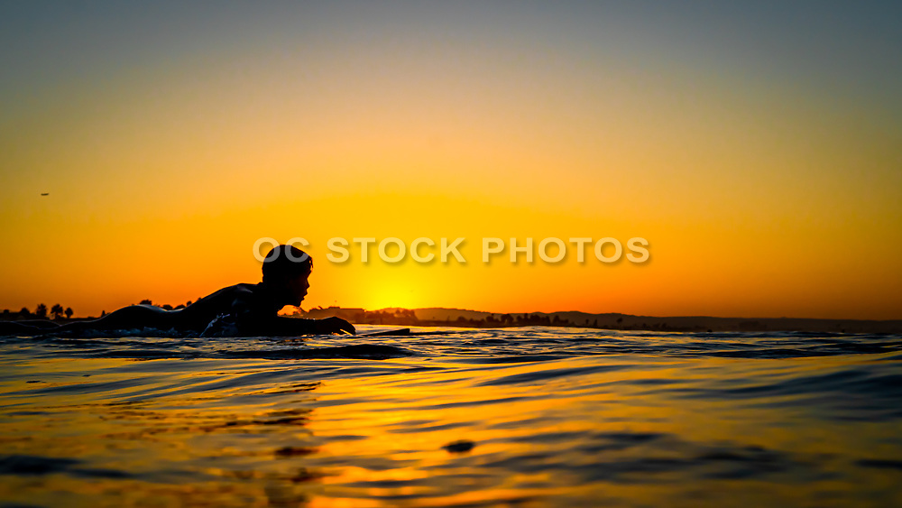 Teen Surfer Silhouette in the Water
