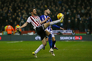 Sheffield United midfielder Chris Basham (6) clears under pressure from Sheffield Wednesday defender Matt Penney (42)  during the EFL Sky Bet Championship match between Sheffield United and Sheffield Wednesday at Bramall Lane, Sheffield, England on 9 November 2018.