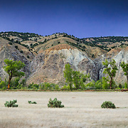 The dry grasslands and Gypsum hillsides in summer near Gypsum Colorado.