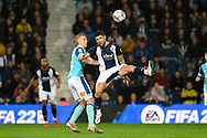 West Bromwich Albion midfielder Alex Mowatt (27) looks to release the ball  under pressure from Derby County midfielder Louie Sibley (17) during the EFL Sky Bet Championship match between West Bromwich Albion and Derby County at The Hawthorns, West Bromwich, England on 14 September 2021.